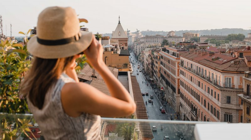 Woman taking a picture at the rooftop
