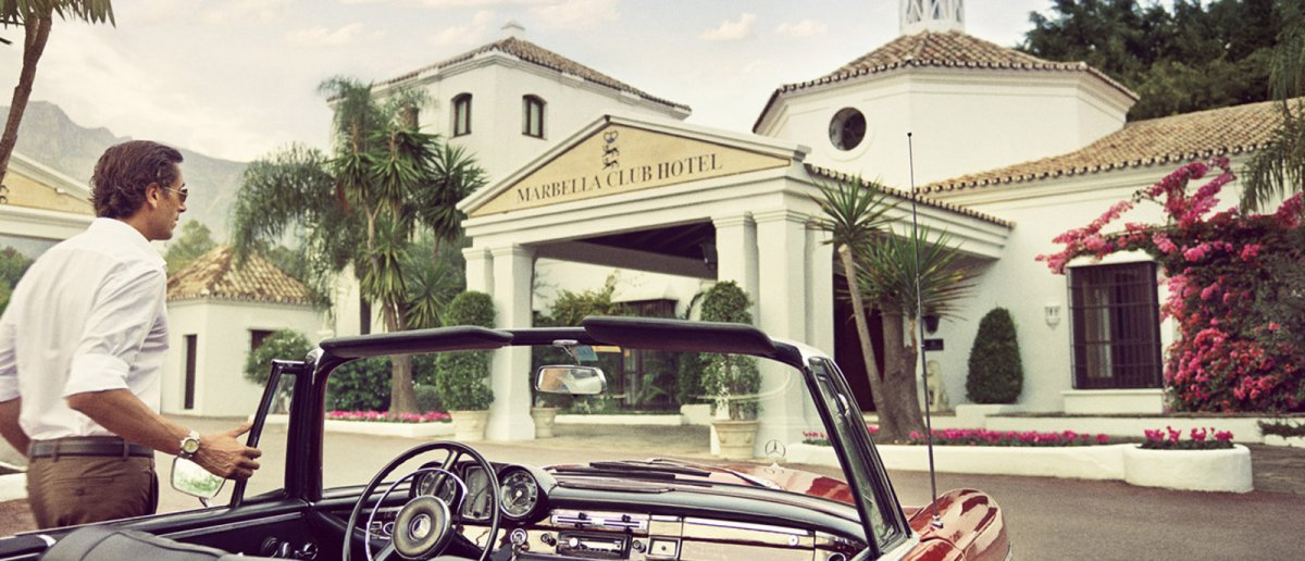 A vintage cabrio by the entrance to Marbella Club Hotel
